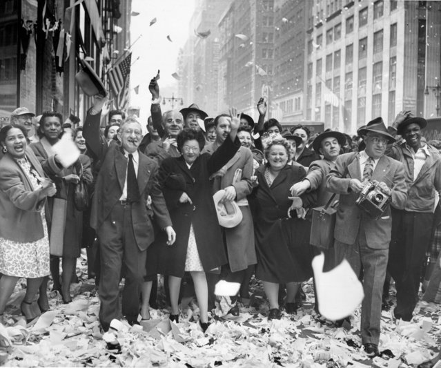New Yorkers Celebrate -- Paper showers down from office Buildings in the Times Square area, New York, May 7, as New Yorkers cheer the news of Germany's unconditional surrender. May 08, 1945. (Photo by New York Post/Photo Archives, LLC via Getty Images)