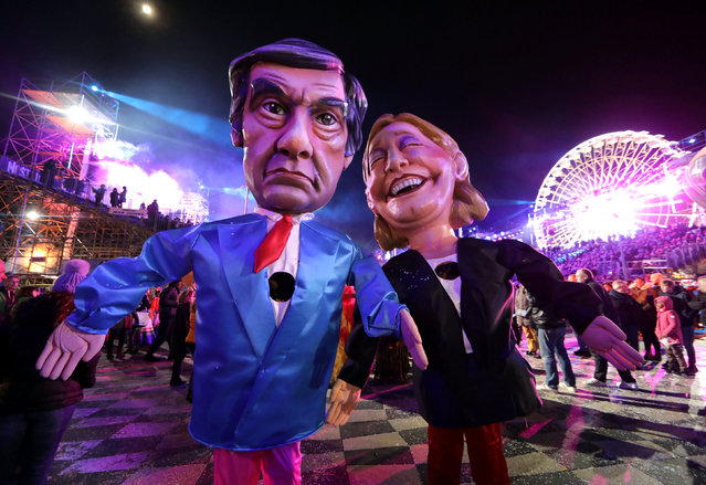 Figures of Francois Fillon (L), former French prime minister, member of The Republicans political party and 2017 presidential candidate of the French centre-right, and French National Front leader Marine Le Pen are paraded through the crowd during the 133rd Carnival parade, the first major event since the city was attacked during Bastille Day celebrations last year in Nice, France, February 11, 2017. (Photo by Eric Gaillard/Reuters)