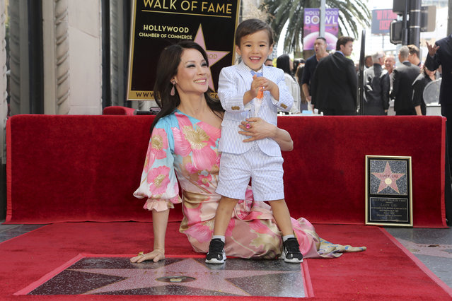 Lucy Liu, left, and her son Rockwell Lloyd Liu pose atop the star following a ceremony honoring Liu with a star on the Hollywood Walk of Fame on Wednesday, May 1, 2019, in Los Angeles. (Photo by Willy Sanjuan/Invision/AP Photo)