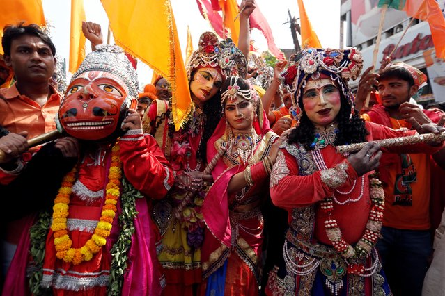 Supporters of Prime Minister Narendra Modi dressed as deities attend a roadshow in Varanasi, India, April 25, 2019. (Photo by Adnan Abidi/Reuters)