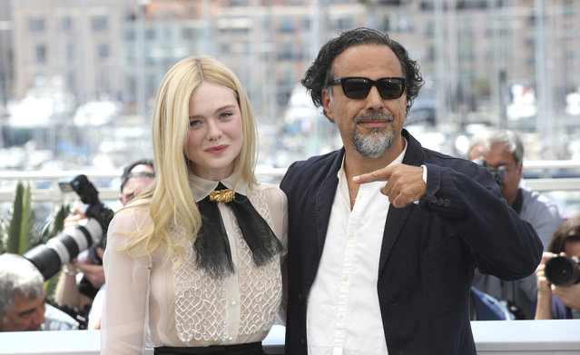Jury member Elle Fanning, left, and jury president Alejandro Gonzalez Inarritu pose for photographers at the photo call for the jury at the 72nd international film festival, Cannes, southern France, Tuesday, May 14, 2019. (Photo by Petros Giannakouris/AP Photo)