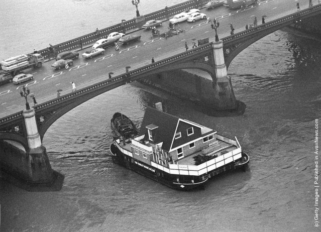 The Sunley House Afloat passing under Westminster Bridge