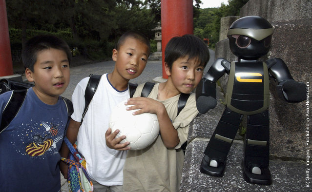 Chroino, the robot, is introduced by its creator Tomotaka Takahashi at Kyoto University