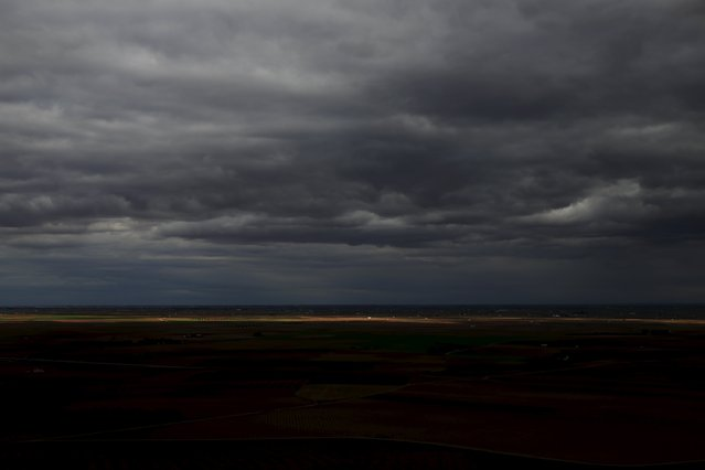 The vast plains of La Mancha are seen from El Cerro de San Anton (Saint Anthony's hill) outside Alcazar de San Juan, Spain, April 5, 2016. (Photo by Susana Vera/Reuters)