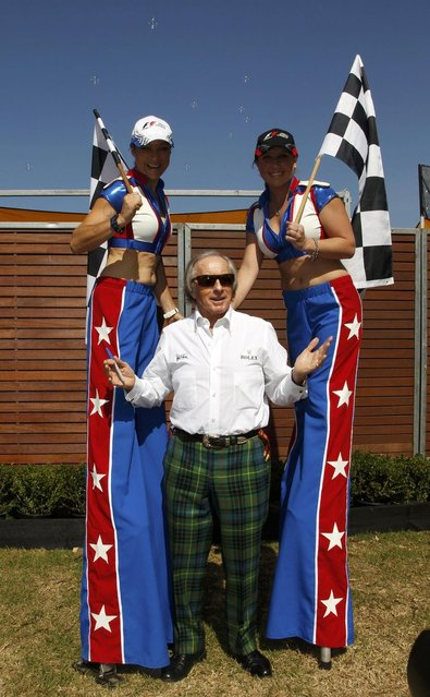 Formula One racing legend Jackie Stewart of Britain (C) attends the first practice session of the Australian F1 Grand Prix at the Albert Park circuit in Melbourne March 14, 2014. (Photo by Brandon Malone/Reuters)