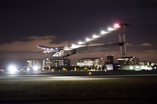Solar Impulse 2 lands at Moffett Field in Mountain View, Calif., after crossing the Pacific Ocean on Saturday, April 23, 2016. The solar-powered airplane landed in California on Saturday, completing a risky, three-day flight across the Pacific Ocean as part of its journey around the world. (Photo by Noah Berger/AP Photo)