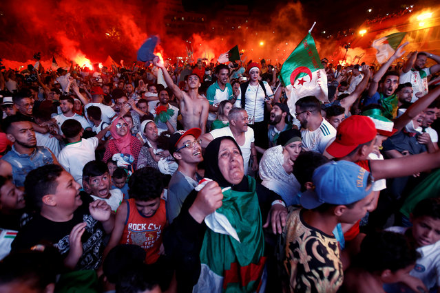 Football fans react after Algeria won the semi-final soccer match against Nigeria in the Africa Cup of Nations 2019, in Algiers, Algeria on July 14, 2019. (Photo by Ramzi Boudina/Reuters)