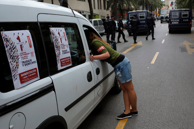 A member of the Comisiones Obreras (CCOO) checks the microphone inside a car as she takes part in a May Day rally in Malaga, Spain, May 1, 2016. (Photo by Jon Nazca/Reuters)