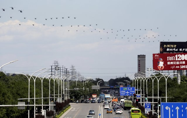 Military helicopters fly in formation during a training session for the upcoming parade marking the 70th anniversary of the end of World War Two, on the outskirts of Beijing, July 2, 2015. Troops from Russia and Mongolia will march together with Chinese forces in a parade in Beijing in September to commemorate the end of World War Two, the government and state media said on Thursday, confirming the first two foreign participants. (Photo by Jason Lee/Reuters)