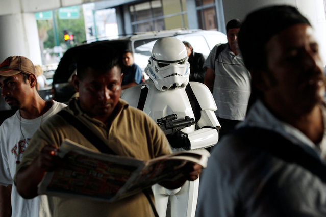 A member of the Star Wars fan club, dressed as a Stormtrooper, is seen among relatives of patients outside a hospital's emergency ward during Star Wars Day celebrations in Monterrey, Mexico May 4, 2016. (Photo by Daniel Becerril/Reuters)