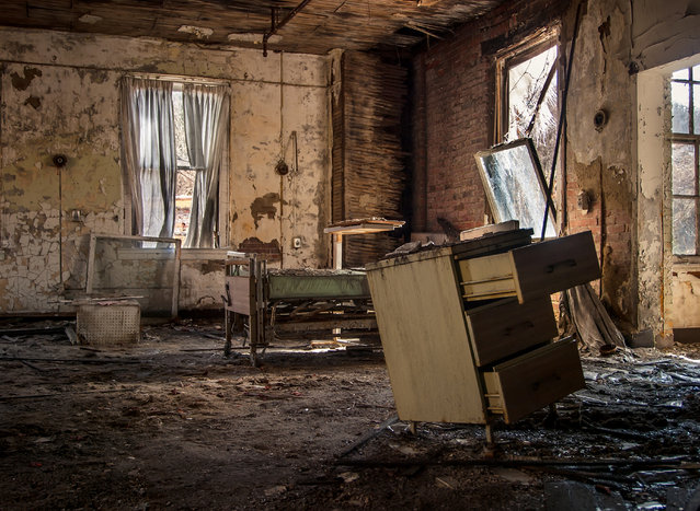 An inside view of the community room of the abandoned Brownsville General Hospital in Pennsylvania. (Photo by Jonny Joo/Barcroft Media)