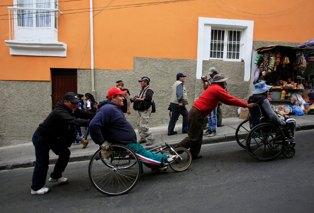 Demonstrators with physical disabilities participates in a rally protest calling on the government to increase their monthly disability subsidy, in La Paz, Bolivia, May 5, 2016. (Photo by David Mercado/Reuters)