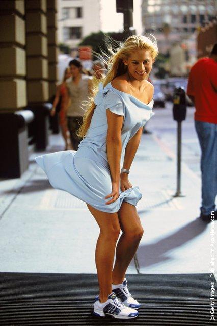 Tennis star Anna Kournikova of Russia recreates a legendary Marilyn Monroe pose