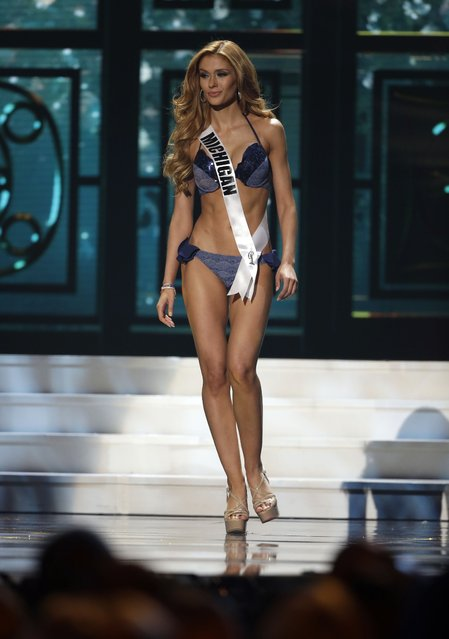 Miss Michigan, Rashontae Wawrzyniak, competes in the bathing suit competition during the preliminary round of the 2015 Miss USA Pageant in Baton Rouge, La., Wednesday, July 8, 2015. (Photo by Gerald Herbert/AP Photo)