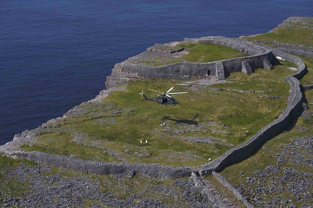 Irish Air Corps deliver maintenance and repair supplies to Dun Aonghasa, a pre-historic stone fort dated from 1100BC on the remote Aran Islands in Galway, Ireland May 13, 2016. (Photo by Clodagh Kilcoyne/Reuters)
