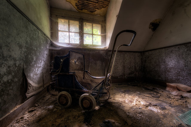 This picture was taken in large, abandoned mansion in Belgium. It has been abandoned since the '80's, but someone's belongings are still there. School books, photographs, newspapers, even the beds ... all under a thick layer of dust and cobwebs. (Photo by Vincent Jansen)