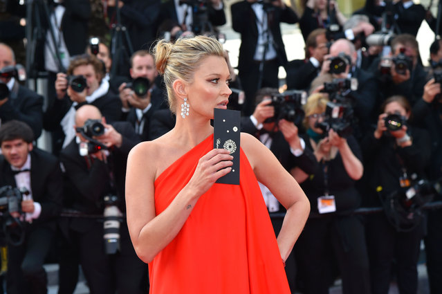 """British model Kate Moss arrives on May 16, 2016 for the screening of the film """"Loving"""" at the 69th Cannes Film Festival in Cannes, southern France. (Photo by Loic Venance/AFP Photo)"""