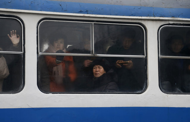 North Koreans ride on a crowded tram in downtown Pyongyang, North Korea, Sunday, February 3, 2019. (Photo by Dita Alangkara/AP Photo)