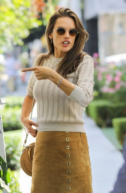 Alessandra Ambrosio puts her flawless supermodel legs on full display as the s*xy 38-year-old dons a chic suede skirt and creme colored knit sweater in West Hollywood Tuesday, October 1, 2019.  The former Victoria's Secret Angel stepped out with a photographer pal to celebrity his birthday at The Ivy. (Photo by X17/SIPA Press)