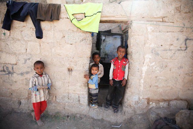 Children stand at the door of their house during a house-to-house vaccination campaign in Sanaa, Yemen February 20, 2017. (Photo by Khaled Abdullah/Reuters)