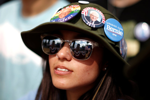 A supporter waits for U.S. Democratic presidential candidate Bernie Sanders to speak in East Los Angeles, California, U.S. May 23, 2016. (Photo by Lucy Nicholson/Reuters)