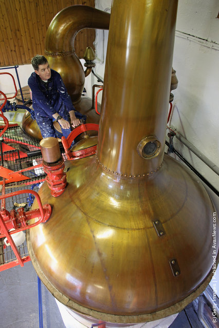 Jimmy Kennedy, works on a copper still at Edradour distillery on March 26, 2012 in Pitlochry, United Kingdom