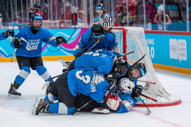 Blue team celebrates their victory after Women's Mixed NOC 3-on-3 Bronze Medal Game during day 6 of the Lausanne 2020 Winter Youth Olympics at Vaudoise Arena on January 15, 2020 in Lausanne, Switzerland. (Photo by RvS.Media/Monika Majer/Getty Images)