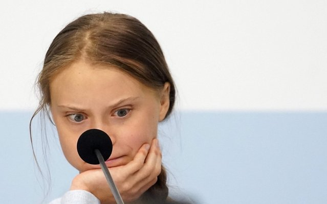 Climate change activist Greta Thunberg reacts during a news conference during COP25 climate summit in Madrid, Spain, December 9, 2019. (Photo by Juan Medina/Reuters)