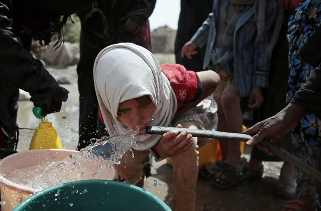 A girl drinks water from a well that is allegedly contaminated with cholera bacteria, on the outskirts of Sanaa, Yemen, Wednesday, July 12, 2017. The U.N. health agency said Tuesday that plans to ship cholera vaccine to Yemen are likely to be shelved over security, access and logistical challenges in the war-torn country. Yemen's suspected cholera caseload has surged past 313,000, causing over 1,700 deaths in the world's largest outbreak. (Photo by Hani Mohammed/AP Photo)