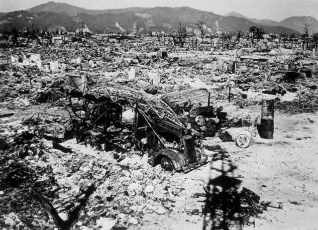 Atomic bomb damage at Hiroshima with a burnt out fire engine amidst the rubble, 1945. (Photo by Keystone/Getty Images)