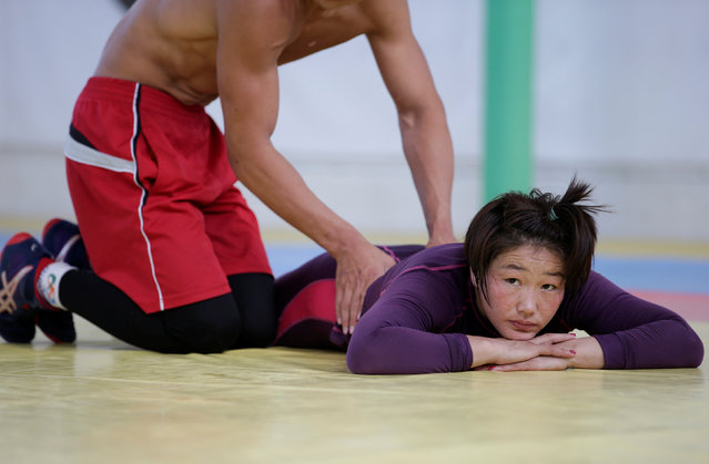 A training partner helps Mongolia's wrestler Sumiya Erdenechimeg stretch after a daily training session at the Mongolia Women's National Wrestling Team training centre in Bayanzurkh district of Ulaanbaatar, Mongolia, July 1, 2016. (Photo by Jason Lee/Reuters)