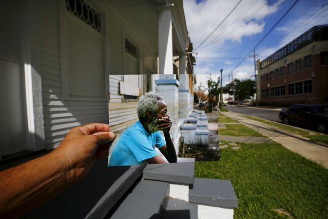 Photographer Carlos Barria holds a print of a photograph he took in 2005, as he matches it up at the same location 10 years on, in New Orleans, United States, August 17, 2015. The print shows Joshua Creek sitting on the porch of his house, September 13, 2005, after Hurricane Katrina struck. (Photo by Carlos Barria/Reuters)
