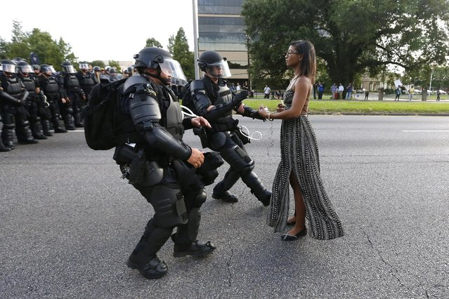 A demonstrator protesting the shooting death of Alton Sterling is detained by law enforcement near the headquarters of the Baton Rouge Police Department in Baton Rouge, Louisiana, U.S. July 9, 2016. (Photo by Jonathan Bachman/Reuters)