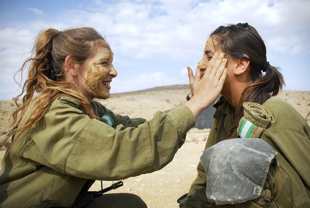 """Female Infantry Instructors Prepare for a Combat Exercise"", November 16, 2010.. The Infantry Instructors Course includes a ""Field Week"" during which soldiers experience drills, live fire, combat exercises, sleeping out in the open, and other aspects of operational activity. The course is held in the Infantry Training School in southern Israel and is attended mostly by girls."