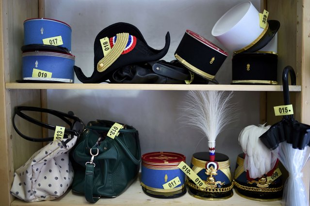 A picture shows a bicorn hat, an umbrella, bags and different types of flat-topped French military caps in a cloakroom at the Defence ministry in Paris, France, during the annual reception in honour of the French Armed Forces July 13, 2016. (Photo by Stephane De Sakutin/Reuters)