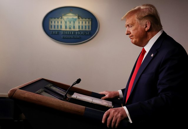 U.S. President Donald Trump pauses as he addresses the daily White House coronavirus response briefing with members of the administration's coronavirus task force at the White House in Washington, U.S., March 18, 2020. (Photo by Jonathan Ernst/Reuters)