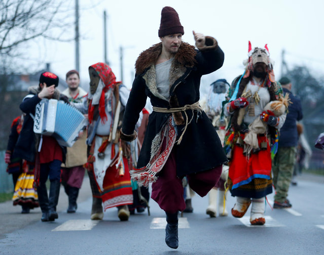 """Artists of Imperial Russian Ballet take part in a festive procession called """"Koniki"""" (Horses) as they visit houses, dance and sing to mark the New Year's Eve according to the Julian calendar, in the village of David-Gorodok, Belarus on January 13, 2020. (Photo by Vasily Fedosenko/Reuters)"""