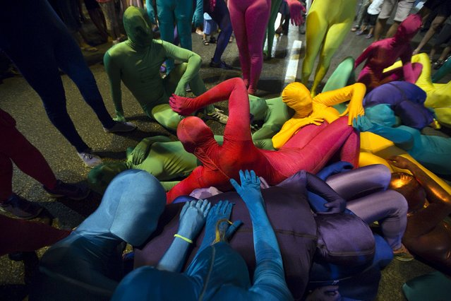 A group of people wearing full solid-coloured bodysuits take part in a street art performance in Bat Yam, near Tel Aviv, Israel August 29, 2015. (Photo by Amir Cohen/Reuters)