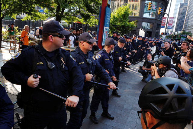 California Highway Patrol officers confront protesters during demonstrations near the Republican National Convention in Cleveland, Ohio, U.S., July 19, 2016. (Photo by Lucas Jackson/Reuters)