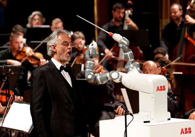 Humanoid robot YuMi conducts the Lucca Philharmonic Orchestra performing a concert alongside Italian tenor Andrea Bocelli at the Verdi Theatre in Pisa, Italy September 12, 2017. (Photo by Remo Casilli/Reuters)