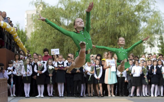 Students perform during an event to mark the upcoming start of another school year in Minsk, Belarus, August 31, 2015. (Photo by Vasily Fedosenko/Reuters)