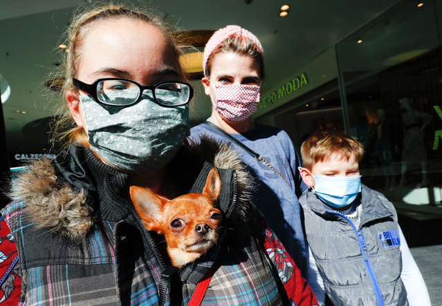 People wearing protective masks are seen, as the spread of the coronavirus disease (COVID-19) continues in Hanau, Germany, April 20, 2020. (Photo by Ralph Orlowski/Reuters)