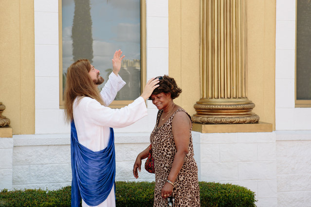 A woman asks the actor who plays Jesus for a blessing at The Holy Land Experience. (Photo by Daniel Cronin)