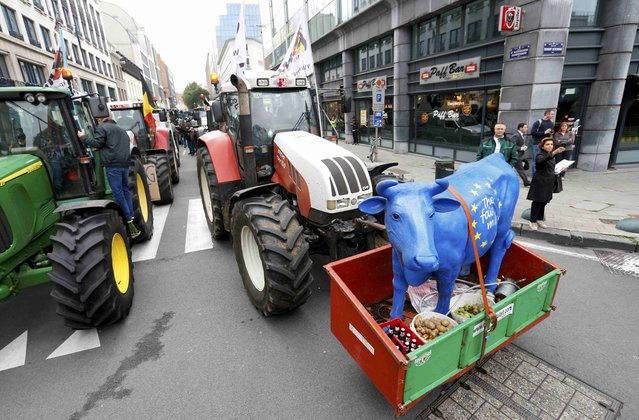 Farmers and dairy farmers from all over Europe drive their tractors towards central Brussels to take part in a demonstration outside an European Union farm ministers emergency meeting at the EU Council headquarters in Brussels, Belgium September 7, 2015. (Photo by Yves Herman/Reuters)
