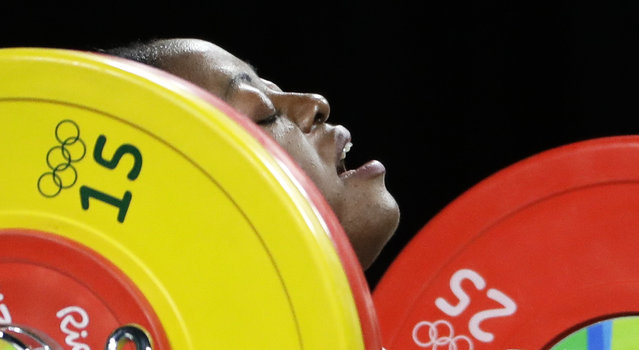 Arcangeline Fouodji Sonkbou, of Cameroon, competes in the women's 69kg weightlifting competition at the 2016 Summer Olympics in Rio de Janeiro, Brazil, Wednesday, August 10, 2016. (Photo by Mike Groll/AP Photo)