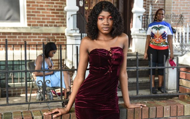 """Marry Ousmane, 18, poses outside while wearing her prom dress on May 29, 2020 in the Brooklyn borough in New York City. Marry Ousmane is best friends with Patrice Toussaint and both are seniors at Edward Murrow high school in Brooklyn whose senior prom was canceled due to all schools being closed during the coronavirus pandemic. Toussaint said, """"I've been planning for four years. I was going to have a send off party with a barbecue and a red carpet. I was going to have two dresses and wear a crown"""". (Photo by Stephanie Keith/Getty Images)"""