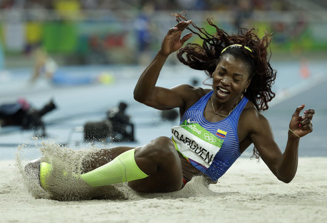 Colombia's Caterine Ibarguen makes an attempt in the women's triple jump final during the athletics competitions of the 2016 Summer Olympics at the Olympic stadium in Rio de Janeiro, Brazil, Sunday, August 14, 2016. (Photo by Matt Dunham/AP Photo)