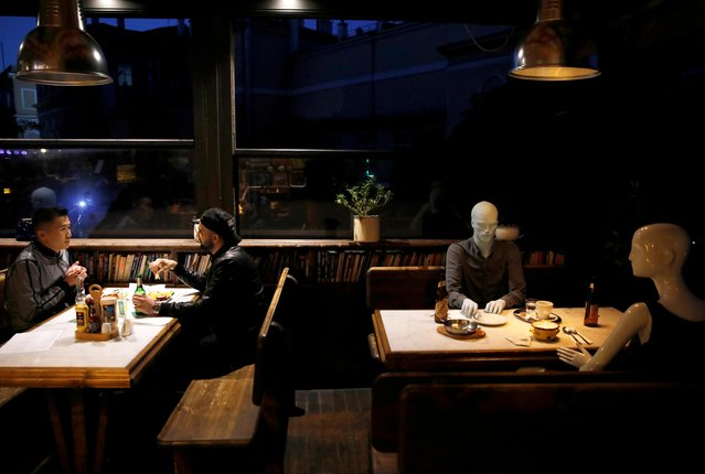 Mannequins are seen placed between tables to make customers sit according to social distancing rules in a bar that reopened after being closed for weeks, amid the spread of the coronavirus disease (COVID-19), in Istanbul, Turkey, June 1, 2020. (Photo by Umit Bektas/Reuters)