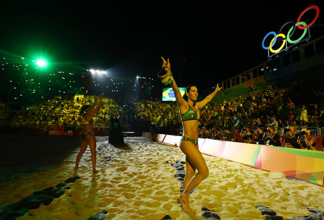 Agatha Bednarczuk Rippel of Brazil and Barbara Seixas de Freitas of Brazil wave to the crowd before the Beach Volleyball Women's Gold medal match against Laura Ludwig of Germany and Kira Walkenhorst of Germany on day 12 of the Rio 2016 Olympic Games at the Beach Volleyball Arena on August 17, 2016 in Rio de Janeiro, Brazil. (Photo by Ezra Shaw/Getty Images)