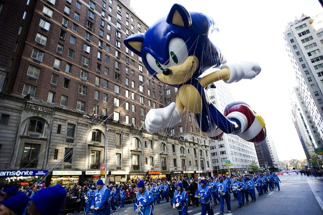 The Sonic the Hedgehog balloon makes its way down Sixth Avenue during the 86th Annual Macy's Thanksgiving Day Parade on November 22, 2012 in New York City. Macy's donated tickets and transportation to this year's Thanksgiving Day Parade to 5,000 people from neighborhoods hardest hit by Superstorm Sandy. (Photo by Charles Sykes/Associated Press)